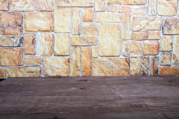 Old wooden table and stone wall