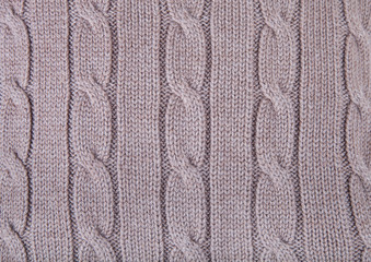 Knitted pattern from woolen warm soft yarn for background
