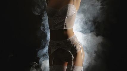 Young girl posing nude, smoke, slow-motion