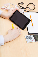 physician calculates with tablet pc
