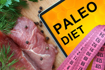 Tablet with Paleo diet and Fresh Meat