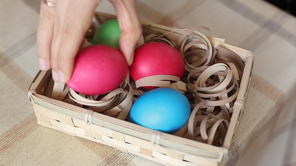 Basket with eggs in woman hands