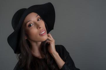 Hispanic fashion model posing at studio. Close up portrait.