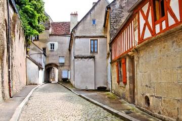 Old cobblestone lane in Semur en Auxois, Burgundy, France