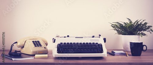 Leinwanddruck Bild Vintage typewriter and phone office