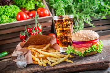 Fresh chicken burger with cold drink and fries