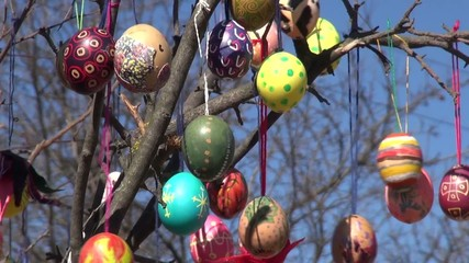 Festive background painted Easter eggs branches tree