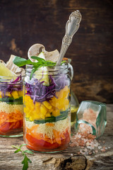 Bright rainbow salad  of tomatoes, carrots, pepper, red cabbage,