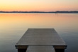 Wooden pier in the Scandinavian evening lake - 81509567