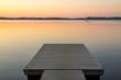 Leinwanddruck Bild - Wooden pier in the Scandinavian evening lake
