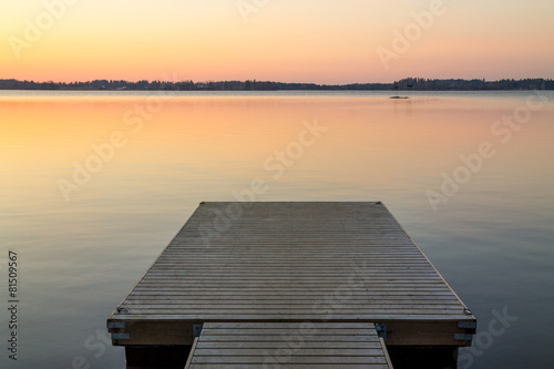 Plexiglas Meer Wooden pier in the Scandinavian evening lake
