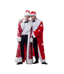 Funny friends posing in coats of Santa Claus