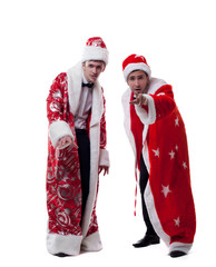 Cute young people posing dressed as Santa Claus