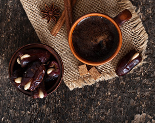 coffee and eastern dates on old wooden background