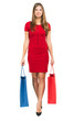 Full length woman in red dress holding shopping bags
