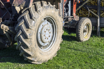 The muddy tractor wheel after working in the field