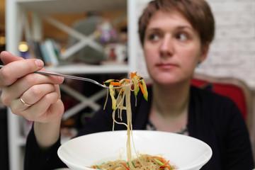 Woman has noodles