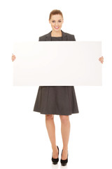 Businesswoman holding empty banner.