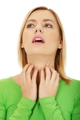 Woman with throat pain.