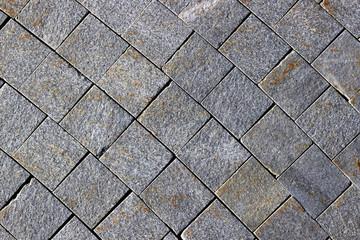 Pavement made of grey granite paving stones
