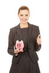 Business woman with piggybank.