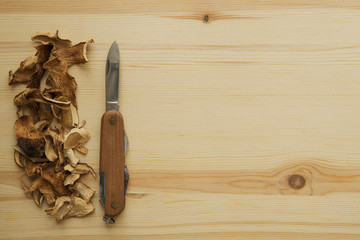 knife and mushrooms on wooden cutting board
