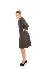 Businesswoman having back pain.