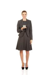 Businesswoman holding model house.