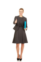 Businesswoman holding a binder.