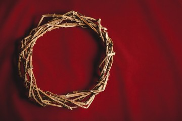 Good. Crown of thorns on red background cloth