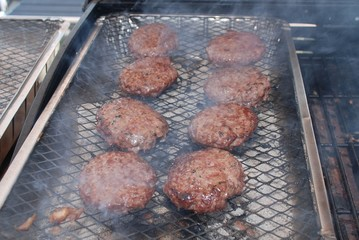 Burgers cooking on a barbecue grill