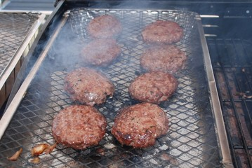 Burgers on a barbecue grill