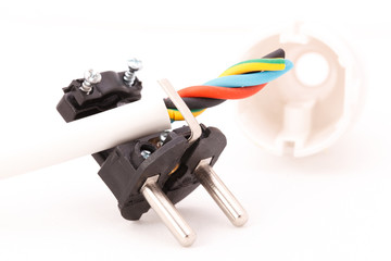 disassembled electric plug and power cord