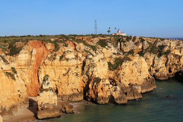lighthouse on cliff in Lagos, Algarve, Portugal