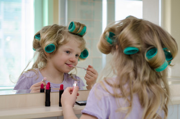 blond girl with lipstick and curlers