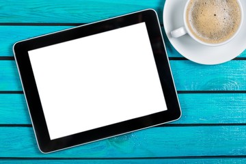 Tablet. Digital tablet and coffee cup on wooden table