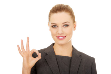 Business woman showing perfect hand sign.
