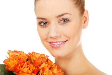 Smiling woman with fresh roses.