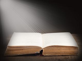 Book illuminated by bright beam of light