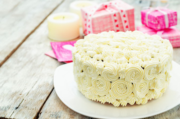 cake with vanilla cream in the form of roses