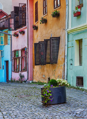 Pastel coloured vintage architecture in Sighisoara, Romania.