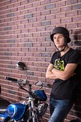 Young Man in Helmet Standing Beside Motorcycle