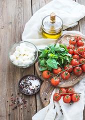 Basil, cherry-tomatoes, mozarella, olive oil,  salt, spices on