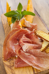 Prosciutto di parma with melon slices