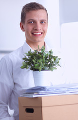 Portrait of a person with moving box and other stuff isolated on