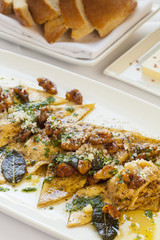 butternut squash ravioli with roasted walnuts, brown butter