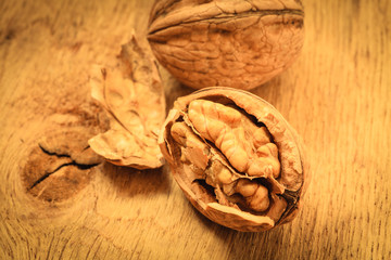 Whole walnuts on rustic old wooden table