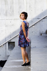Asian American Woman In Floral Dress Looking Over Shoulder