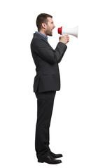man in black suit with megaphone