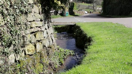 Stream water flows by Countryside Village Road